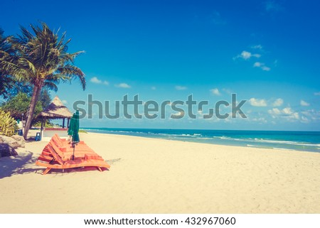 Vintage Filter - Umbrella and chair on beautiful tropical beach and sea - Boost up color Processing - Holiday vacation concept background