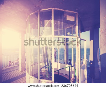 Vintage filtered picture of lighthouse top part. - stock photo
