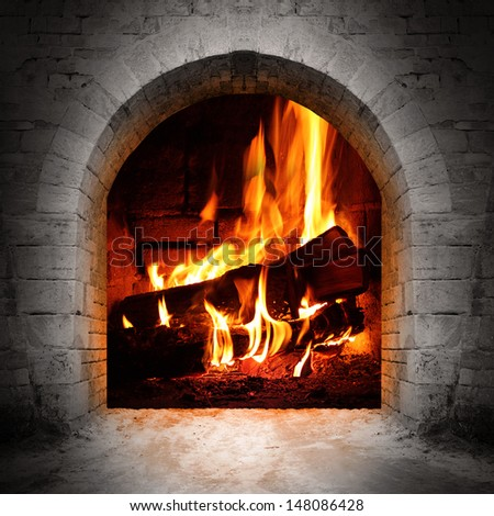 Vintage fireplace with burning logs.  - stock photo