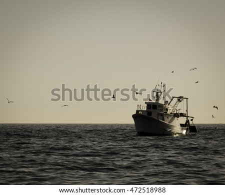 vintage fishing vessel with seagulls