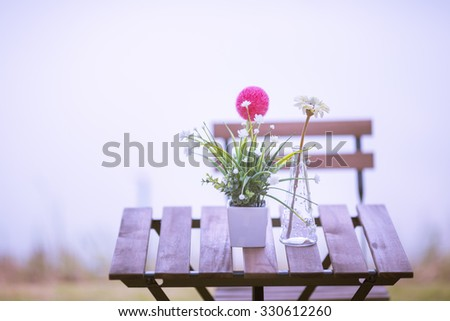 vintage flower on wood table.