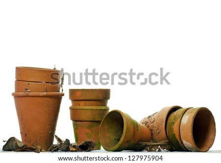 Vintage flowerpots; isolated against white ground - stock photo