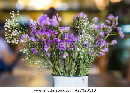 Vintage flowers on wooden in cafe background, Bouquet flower - stock photo