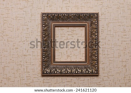 Vintage frame on beige paper textured background - stock photo