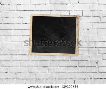 vintage frame on brick wall background - stock photo