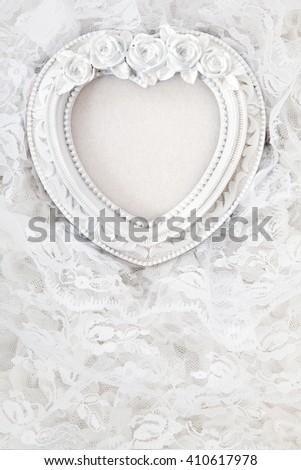 Vintage frame on white lace background - stock photo