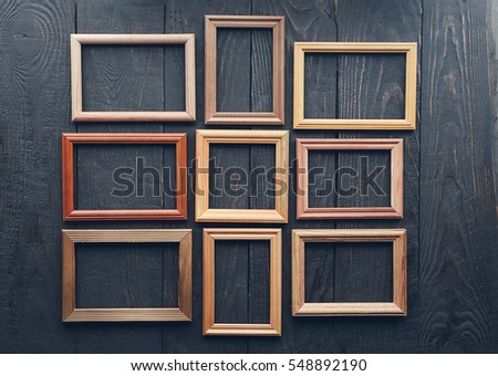 vintage frames on old wooden wall