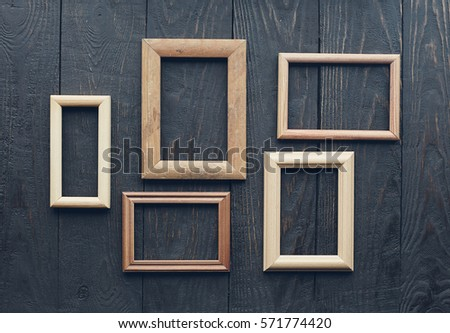 Vintage Frames On Old Wooden Wall Stock Photo 571774420 - Shutterstock