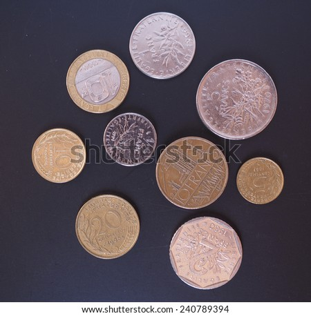 Vintage French Francs coins withdrawn since the introduction of Euro - stock photo