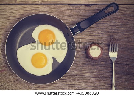 Vintage. Fried egg in a frying pan - stock photo