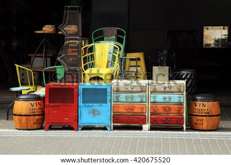 Vintage furniture and other staff at entry to shop at Jaffa flea market district in Tel Aviv-Jaffa, Israel. - stock photo