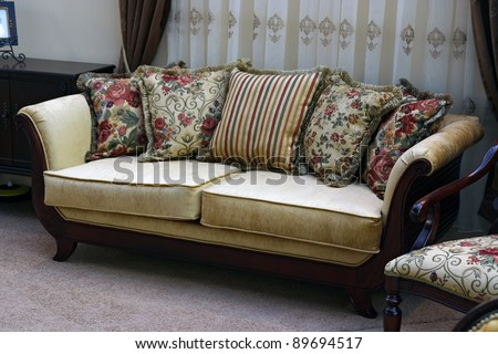 Vintage furniture sofa with pillows. Vintage furniture set. - stock photo
