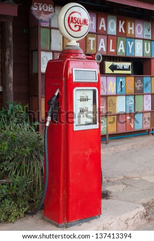 VIntage Gas Pump. Old red gas pump. - stock photo