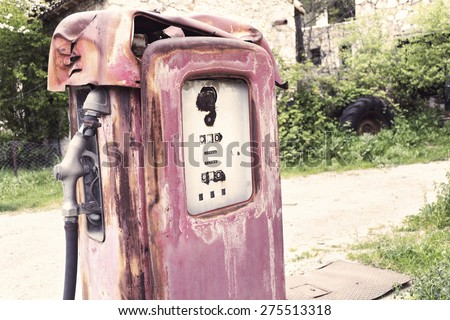 Vintage gas pump. Processed with vintage washed colors - stock photo