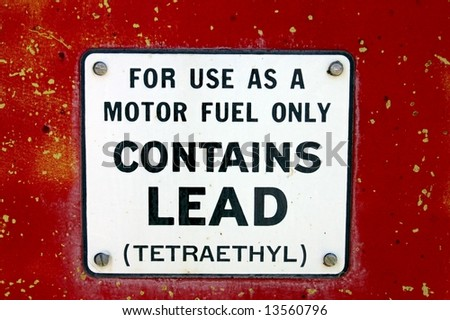Vintage Gas Pump With Lead Sign - stock photo