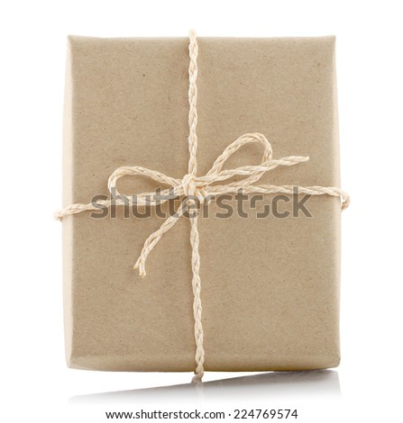 Vintage gift box brown paper wrapped with rope  isolated over white background. This has clipping path. - stock photo