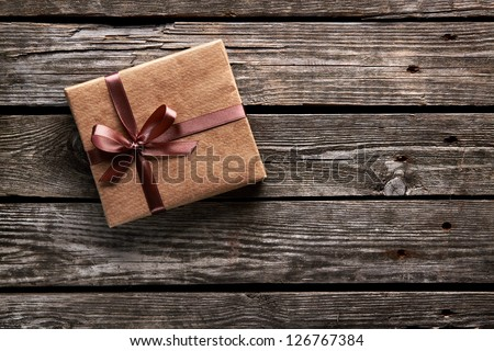 Vintage gift box on old wooden background. - stock photo