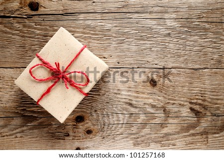 Vintage gift box on wooden background - stock photo