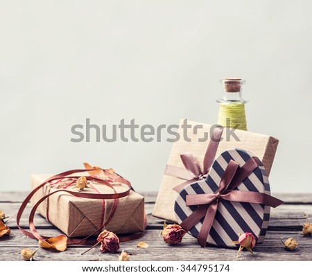 Vintage gift boxes on a table - stock photo