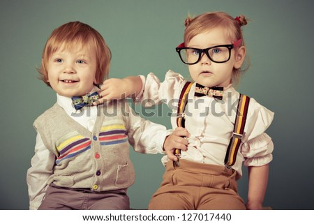 Vintage  girl and boy on a green background. - stock photo