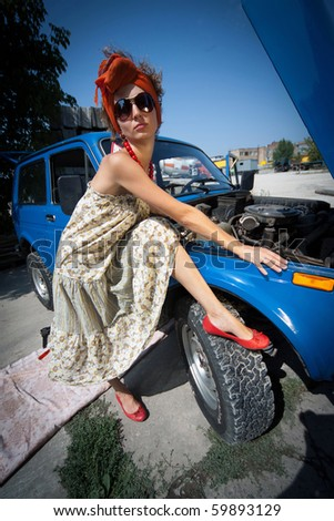 Vintage girl posing in front of the car - stock photo