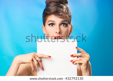 Vintage Girl with red nails holding a blank form for advertising - stock photo