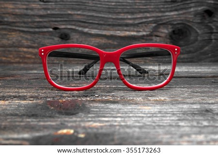vintage glasses isolated on a wooden background