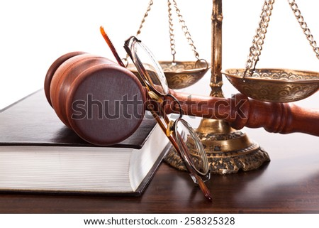 Vintage glasses judge, gavel, bronze scales, a book on a white background - stock photo