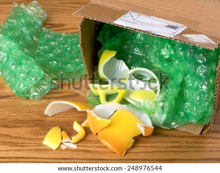 Vintage Glassware Broken in shipping due to not being adequately wrapped well enough by auction seller.  Bad practice for business reputation concept.  Horizontal above looking down view.   - stock photo