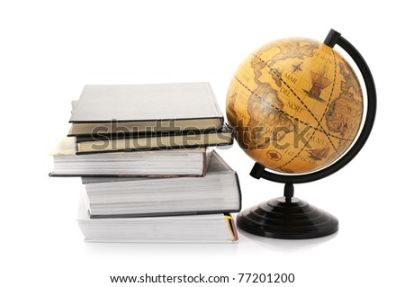 Vintage globe and stack of books isolated on white background. - stock photo