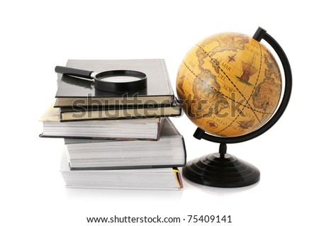 Vintage globe, stack of books and magnifier isolated on white background.