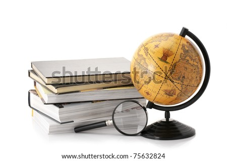 Vintage globe, stack of books and magnifier isolated on white background. - stock photo