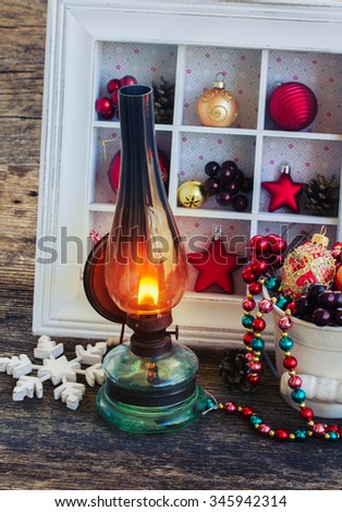 vintage glowing  lantern with  christmas decorations, low key - stock photo
