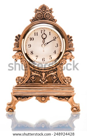 Vintage gold plated clock isolated