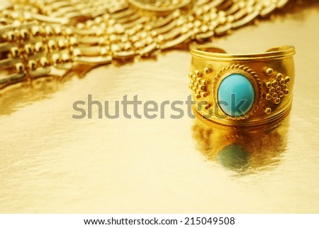 Vintage gold ring with jewelry on gold background Copy space Studio shot - stock photo