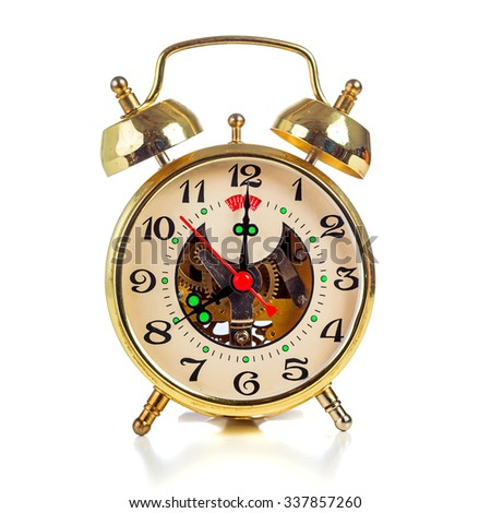Vintage golden alarm clock on white background showing eight o'clock - stock photo