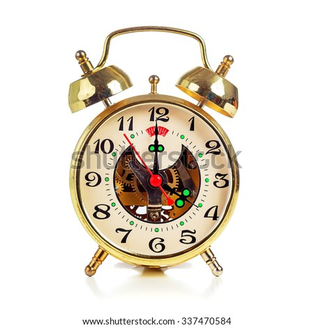 Vintage golden alarm clock on white background showing four o'clock - stock photo