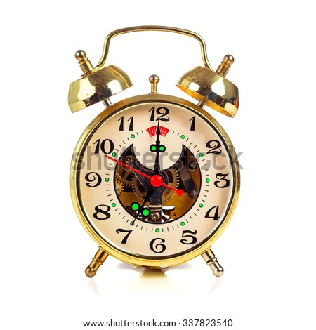 Vintage golden alarm clock on white background showing seven o'clock - stock photo
