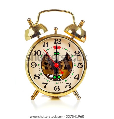 Vintage golden alarm clock on white background showing six o'clock - stock photo