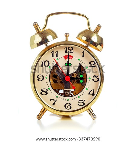 Vintage golden alarm clock on white background showing three o'clock - stock photo
