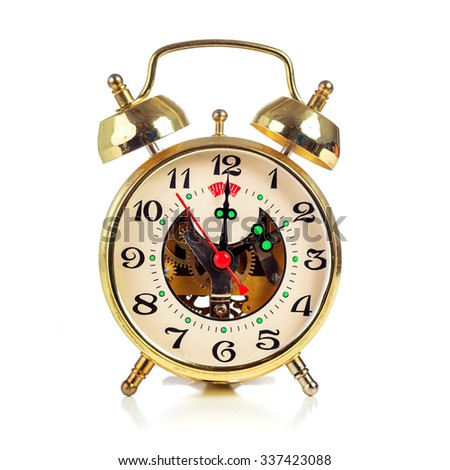 Vintage golden alarm clock on white background showing two o'clock - stock photo