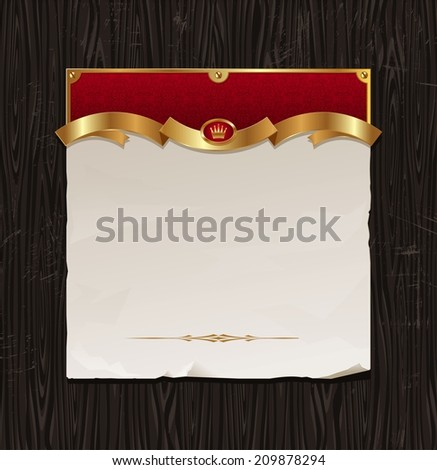 Vintage golden frame with paper banner on a black wood background - stock photo