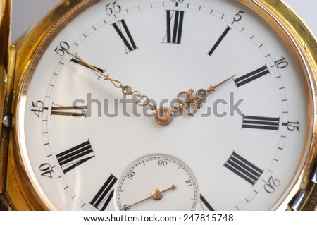 Vintage golden pocket watch - stock photo