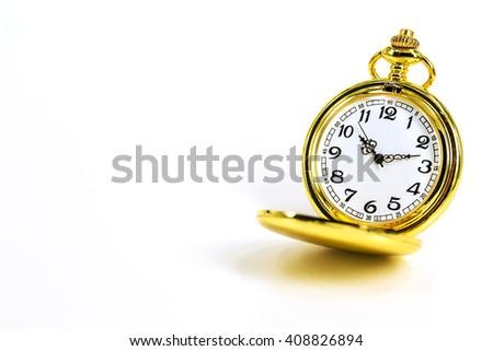 vintage golden pocket watch isolated on white background. - stock photo