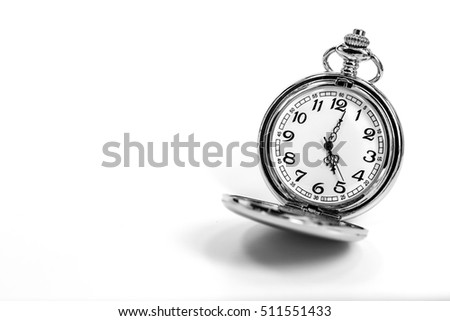vintage golden pocket watch isolated on white background.
