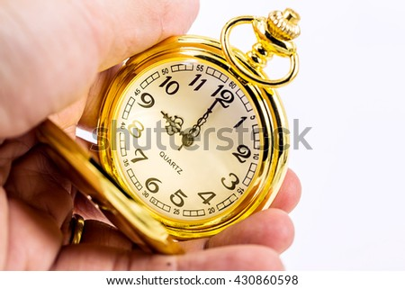 vintage golden pocket watch on hand isolated on white background. - stock photo