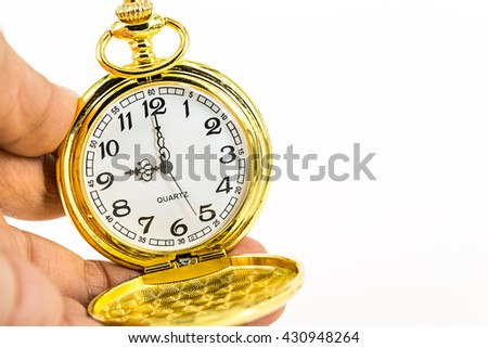 vintage golden pocket watch on hand isolated on white background.