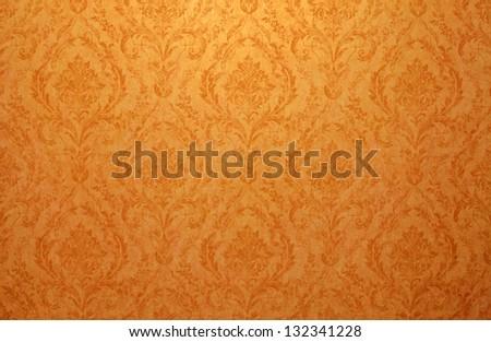 Vintage golden run-down victorian wallpaper with baroque vignette - stock photo