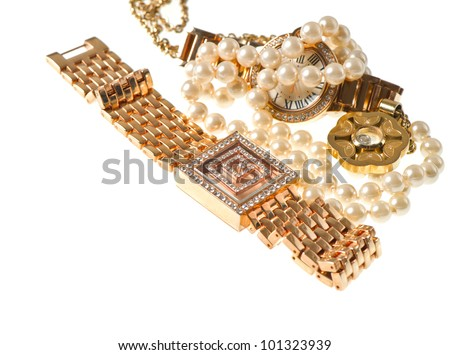 vintage golden watch with gems and jewelry on white background. selective focus