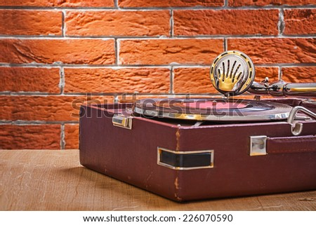 vintage gramophone on wooden table close up view - stock photo